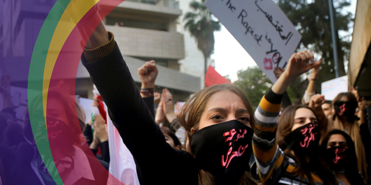 Protesters Wearing Black Masks with Pink Lettering